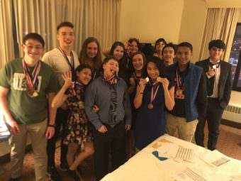 The JDHS academic decathlon teams pose with their medals.