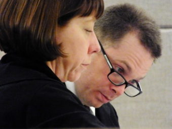 Defense attorney Eve Soutiere and defendant Christopher Strawn look over documents during the start of his homicide trial on Feb. 6, 2017.
