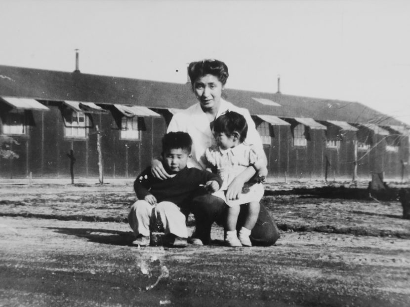 This 1945 photo provided by the family shows Shizuko Ina, with her son Kiyoshi (left) and daughter Satsuki in an internment camp in Tule Lake, Calif. This photograph was taken by a family friend who was a soldier at the time, since cameras were considered contraband at the camp. Satsuki was born at the camp. Courtesy of the Ina family/AP