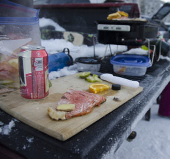 A filet of salmon is prepped for the barbecue on Dec. 13, 2015, in the parking lot of Eaglecrest Ski Area. (Photo courtesy Sarah Cannard)