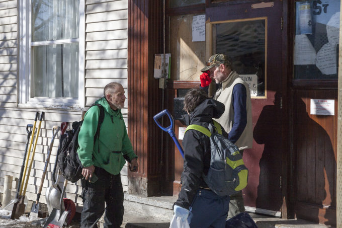 Residents of the Bergmann Hotel talk about what they're supposed to do before police showed up to remove them from the building on Friday, March 10, 2017 in Juneau, Alaska.