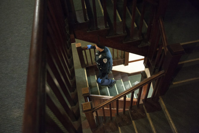 Juneau police officers moved through the Bergmann Hotel, telling residents they had to leave on Friday, March 10, 2017 in Juneau, Alaska.