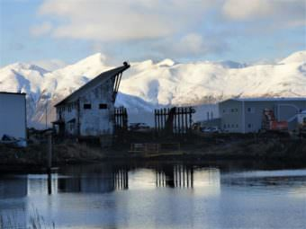 Unalaska's marine railway stands half-demolished in December. The World War II structure has since been leveled, about 75 years after it was built. (Photo by Laura Kraegel/KUCB)