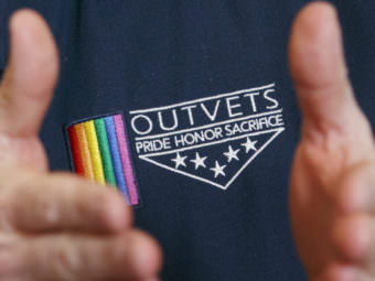 OutVets founder Bryan Bishop wears the logo of his group while speaking in Boston. The group has been invited to participate in the city's privately-run St. Patrick's Day parade. Michael Dwyer/AP