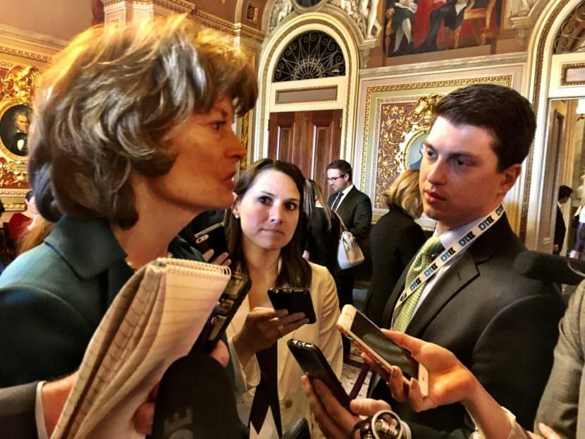 U.S. Sen. Lisa Murkowski, R-Alaska, speaks to reporters in one of the Senate's more ornate rooms. (Photo by Liz Ruskin/Alaska Public Media)