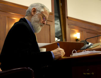Rep. Paul Seaton. R-Homer, works at his desk in the House Chambers during the hours-long deliberations on HB 111, an oil tax bill, April 10 , 2017. (Photo by Skip Gray/360 North)