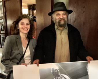Judith Rubin and her brother, David, show a poster of their statue at a luncheon at the National Press Club. (Photos by Liz Ruskin/Alaska Public Media)
