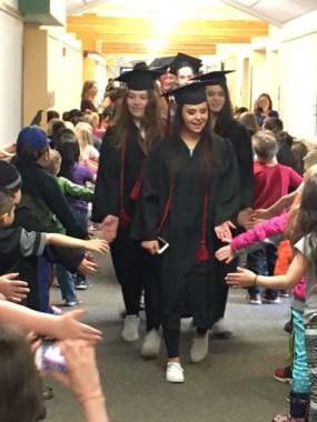 Juneau-Douglas seniors walk through Harborview Elementary School on Friday.