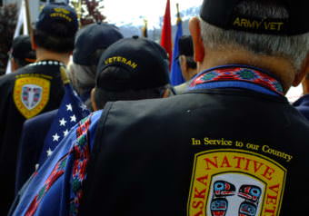 Veteran flag-bearers wait for start of a 2017 Memorial Day observance at Southeast Alaska Native Veterans Memorial Park. (Photo by Matt Miller/KTOO)