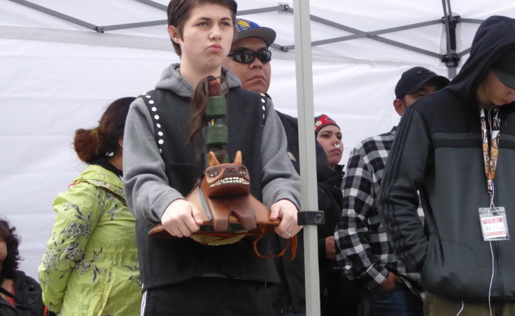 Boy holding a carving at Saturday's ceremony.