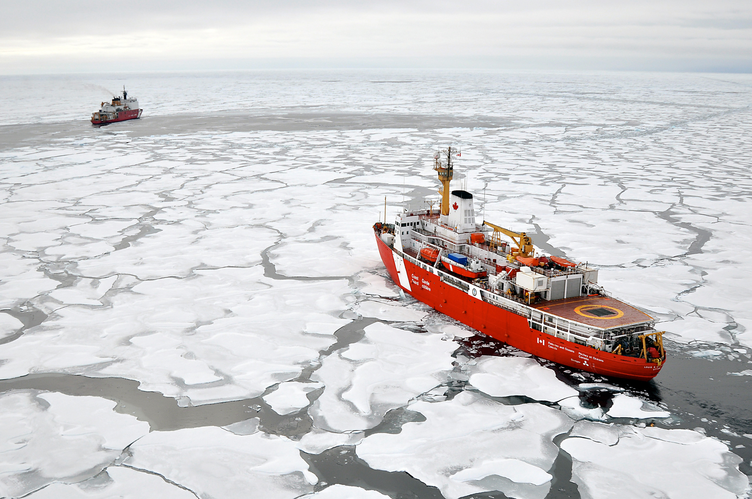 f81925b243 Canadian Coast Guard ship Louis S. St-Laurent makes an approach to the Coast  Guard cutter Healy in the Arctic Ocean Sept. 2009. As Arctic marine traffic  ...