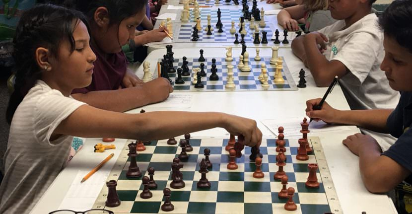 Killip Elementary third-graders Alexa Cardenas, left, and Luis Gonzalez, right, are preparing for the chess SuperNationals. (Photo by Laurel Morales/Fronteras)