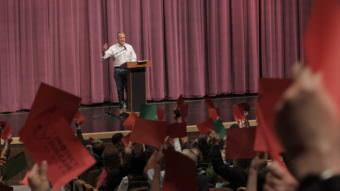 Red cards, signaling disagreement, often predominated at Sen. Dan Sullivan's town hall May 20 in Anchorage. (Photo by Wesley Early/Alaska Public Media)