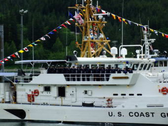 Ship's crew salute during commissioning of USCGC Bailey Barco in Juneau June 14, 2017.