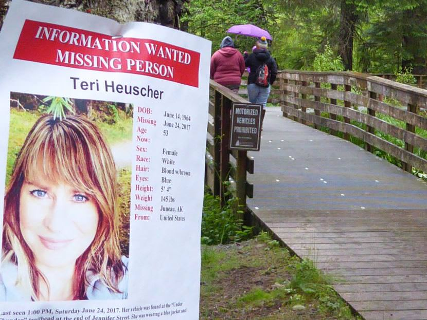 A flyer posted on Monday, June 26, 2017, at the Under Thunder trailhead off Jennifer Drive in the Mendenhall Valley states that Teri Heuscher is missing. The 53-year-old Juneau woman's vehicle was found there Saturday, June 24, 2017. (Photo by Quinton Chandler/KTOO)