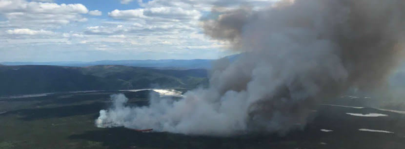 The North Robertson Fire burning about 2 miles west of the Alaska Highway near milepost 1350 is now estimated at 800 acres. (Photo by Tim Whitesell/Alaska Division of Forestry)