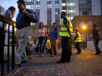 Officials evacuate residents of the Chalcots Estate, in London's Camden borough on Friday evening. Camden's local council decided to evacuate the hundreds of households due to safety concerns following the devastating fire that killed 79 people in Grenfell Tower.
