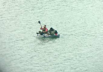 A man paddles a homemade watercraft June 7, 2017, in the Gastineau channel near Juneau. A Coast Guard Station Juneau small boat crew rescued a 32-year-old man after the craft began taking on water. (Photo courtesy of U.S. Coast Guard)