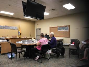 Homer's canvas board counts absentee ballots in recall election. (Photo by Aaron Bolton/KBBI)