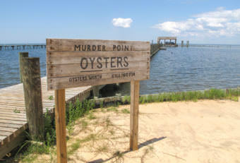 """The Zirlott family's oyster farm is at the end of a long pier in Sandy Bay. Legend has it that the name """"Murder Point"""" comes from a deadly dispute over an oyster lease at this site back in 1929. Debbie Elliott/NPR"""