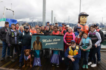 "Members of the Coast Guard and residents of Seward wear life jackets for the ""Ready, Set, Wear It!"" Life Jacket World Record Day event at the Seward Harbor on May 20, 2017. The event marked the first day of National Safe Boating Week during the Seward Harbor Opening festivities."