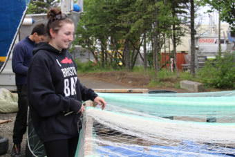 Maddy Marinkovich learned to stitch nets from her father. (Photo by Caitlin Tan/KDLG)