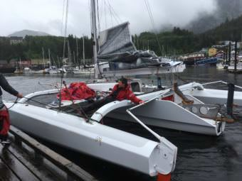 Chris Burd laughs as his brothers tie up their boat in Ketchikan after winning the 2017 Race to Alaska. (Photo by Leila Kheiry/KRBD)