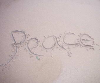 Peace written in sand.
