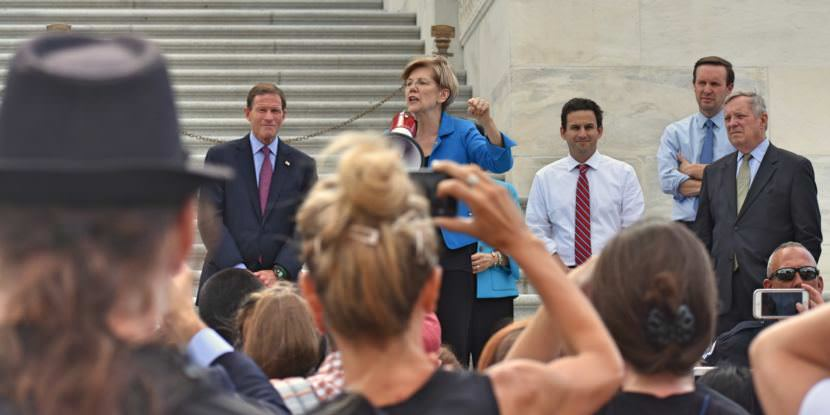Sen. Elizabeth Warren, D-Massachusetts, addresses a crowd outside the U.S. Capitol in Washington protesting the Republican health care bill on July 25, 2017.