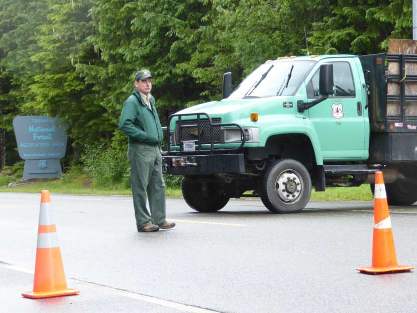 District Ranger Brad Orr standing behind the barricade blocking the Mendenhall Glacier Recreation Area to traffic.