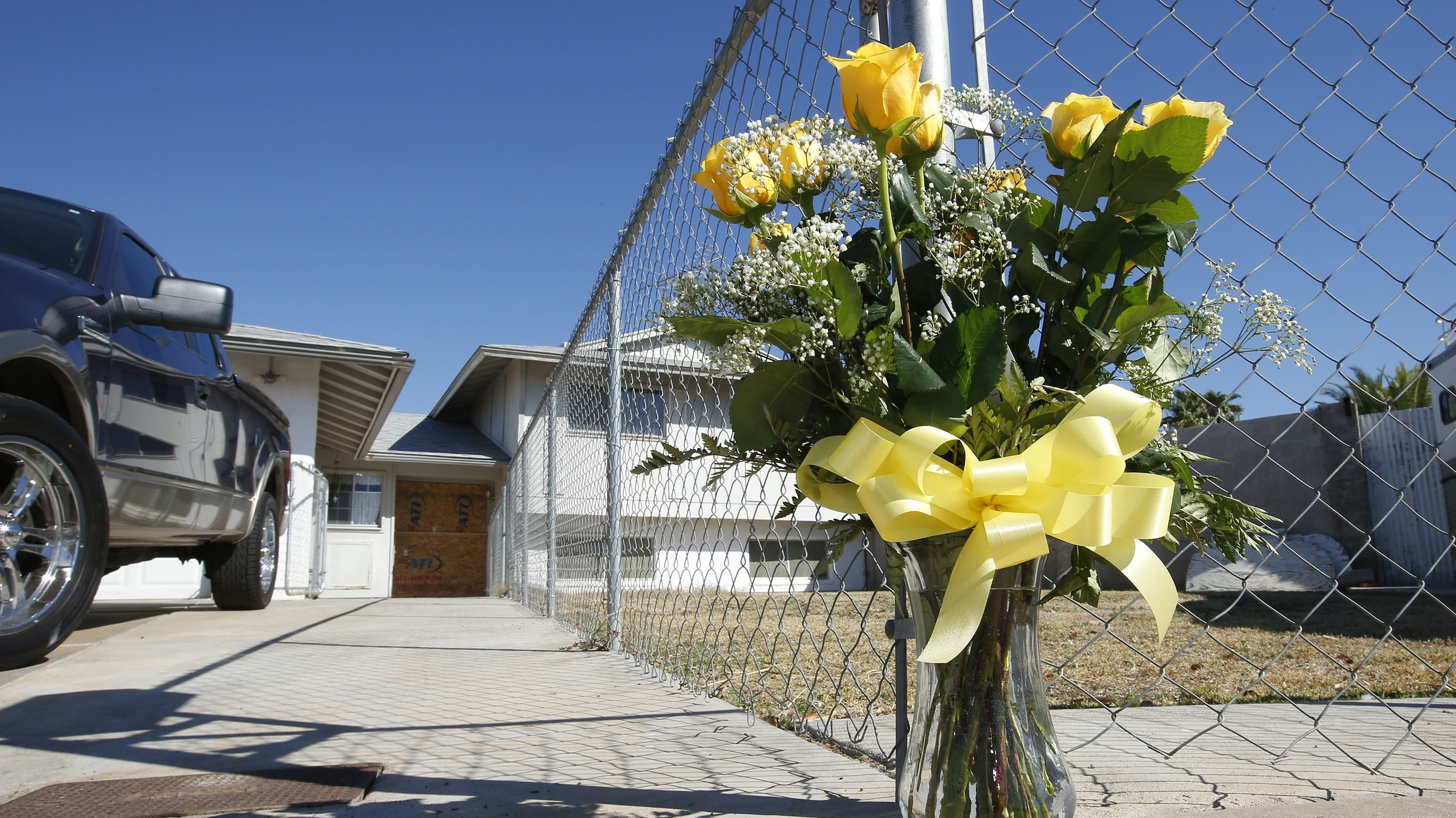 A Lone Bouquet Of Flowers Stands In Front Of A Home In Phoenix In