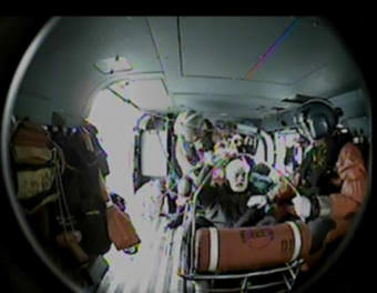 In this screen capture, Coast Guard Air Station Sitka crew aboard a MH-60 Jayhawk hoist a man experiencing chest pain from a fishing vessel in Southeast Alaska. (Screen capture courtesy U.S. Coast Guard)