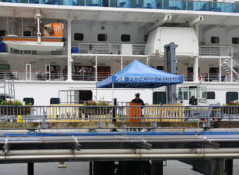 Passengers wait aboard the Emerald Princess moored on the South Franklin Street Dock in Juneau on Wednesday, July 27, 2017. The FBI investigated an alleged murder after a Utah woman died the day before on the ship.