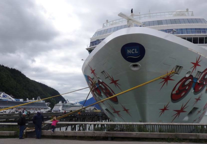The Norwegian Pearl tied up at Skagway's Broadway dock in July 2017. Two more cruise ships are moored at the railroad dock in the background. (Photo by Emily Files/KHNS)