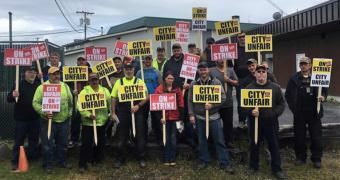 Wrangell municipal employees represented by the International Brotherhood of Electrical Workers pose on the picket line June 22, 2017. They've since reached a new contract agreement with the borough, which now goes before the Assembly. (Photo courtesy IBEW )
