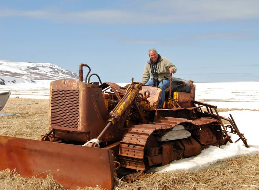 Mike Coffey poses on an old bulldozer in the Bethel area in 2009. He's retiring from his job as Department of Transportation Southcoast Region director. (Photo courtesy Department of Transportation)