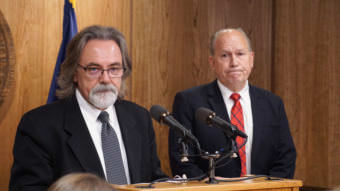 Department of Revenue Commissioner Randall Hoffbeck discusses a compromise budget package with reporters as Gov. Bill Walker listens in the cabinet room of the Capitol in Juneau on June 6, 2017. (Photo by Jeremy Hsieh/KTOO)