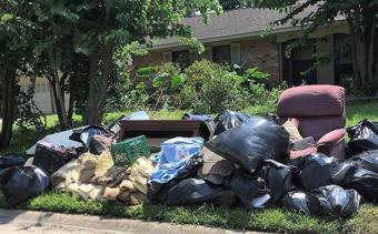 "Ruined furniture and other trash pile up on the curb in Houston's Braeburn Glen neighborhood, where Sophi Zimmerman and her family live. Flooding destroyed furnishings, floors and household items. ""Here's how it looks in front of every house on our block,"" Zimmerman said. (Photo courtesy Sophi Zimmerman)"