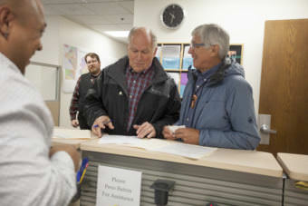 Alaska Gov. Bill Walker and Lt. Gov. Byron Mallott file for re-election on Monday, August 21, 2017, at the Division of Elections in Juneau, Alaska. The two are filing as unaffiliated candidates -- though Mallott maintains his personal affiliation with the Democratic party. (Photo by Rashah McChesney/Alaska's Energy Desk)