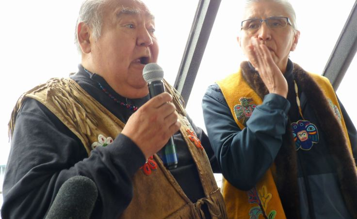 Paul Marks. right, and David Katzeek speak in Tlingit and English during a recent tour of traditional T'aaḵu Kwáan lands. (Photo by Ed Schoenfeld/CoastAlaska News)