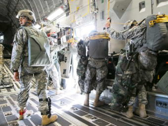 Airborne infantrymen from the 4-25 preparing to jump from a C-17 into Australia during a training mission in July 2015 (Photo by Zachariah Hughes/Alaska Public Media)