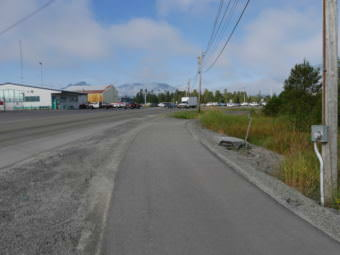 One idea for additional parking would add a new lot across from the Alaska Airlines terminal, Haugen Drive and the bike path. (Photo by Joe Viechnicki/KFSK)