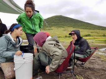 Orutsaramiut Native Council partner fisheries biologist Janessa Esquible helps campers identify juvenile salmon. (Photo by Christine Trudeau/KYUK)
