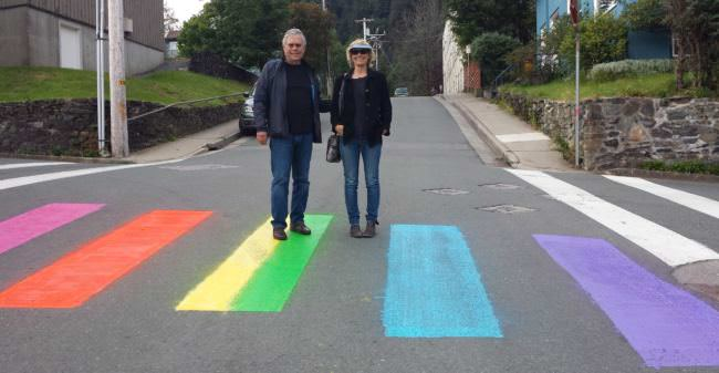 An unidentified couple pose for the recently painted rainbow crosswalk at the intersection of 7th and Gold streets in August 2016. (Photo courtesy Sue Warner)