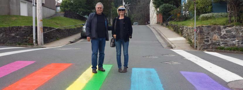 An unidentified couple pose for the recently painted rainbow crosswalk at the intersection of 7th and Gold streets in August 2016. (Photo courtesy of Sue Warner)