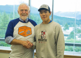 UAS Chancellor Rick Caulfield poses with incoming freshman Triston Chaney from Dillingham who is pursuing his undergraduate degree in Marine Biology this semester. (Photo by Annie Bartholomew/KTOO)