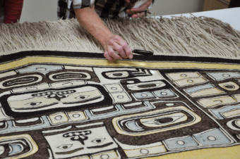 This 100-year-old Chilkat robe will be honored at a homecoming ceremony on Saturday, Aug. 26, 2017, in the Walter Soboleff Building in Juneau. (Photo by Davina Cole/Sealaska Heritage Institute)