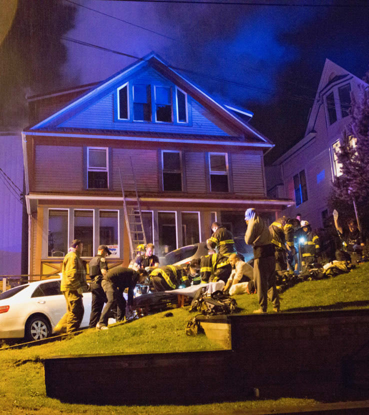 EMTs work on patients during a house fire at 526 Seward Street on Sept. 17, 2017. (Photo courtesy of Brian Wallace)
