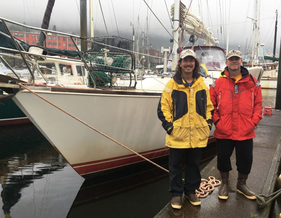 Seth Meyer, left, and Chris Anderson stand at Ketchikan's Bar Harbor South, where the Sea Bear was tied up Sept. 22, 2017. (Photo by Leila Kheiry/KRBD)