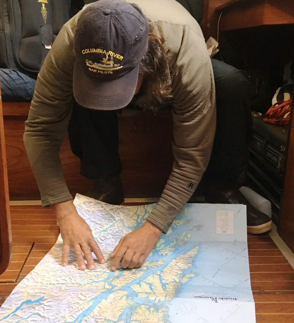 On board the Sea Bear, Seth Meyer shows the route through Alaska's Inside Passage. (Photo by Leila Kheiry/KRBD)